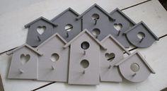 houten kapstok met 5 vogelhuisjes