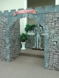 The Mighty God VBS 2013 stone wall is preprinted 30ft plastic. Entrance stones painted styrofoam. Top trim of castle, painted cardboard.