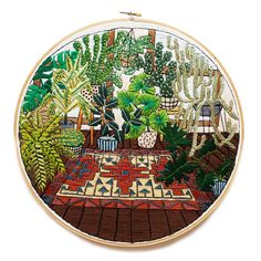 """Sarah K. Benning happened upon embroidery """"almost by accident,"""" and turned the craft into a career. She's best know for her intricately-detailed interiors of potted plants, and cites """"interior design trends, a love for Midcentury design, antique textiles, and her own potted plant collection"""" as inspiration. Like Cinder & Honey, she sells patterns of her work for those who want to embroider themselves."""