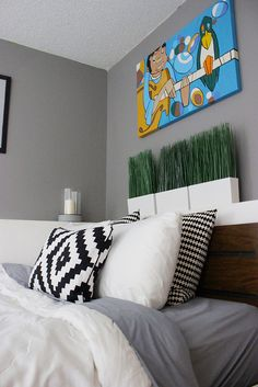 what I like: simple colors (black/white), bold neutral print w/ select bright colors, love grey walls mixed with brown bedframe.