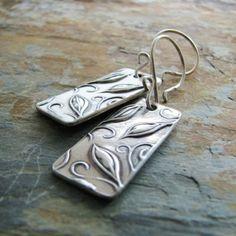 Image from http://www.artfire.com/uploads/product/1/761/85761/4985761/4985761/large/everlasting_handmade_pmc_fine_silver_earrings_from_artisan_origin____2475a8dd.jpg.
