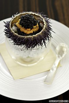 fresh uni, botan ebi, and caviar in an uni shell at waku ghin, singapore.