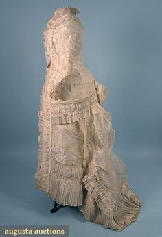"TRAINED SILK ORGANDY WEDDING GOWN, c. 1878  1-piece w/ ruched & pleated fabric, B 34"", W 25.5"", Front L 51"", Back L 64"", (few minor stains) excellent."