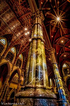 Stained Columns - The sun shines through stained glass onto the columns at Holy Name Cathedral in Chicago