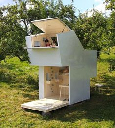 Unfolding like a gift from a box-like form, this cute little white cabin has a tiny footprint but big personality. The Soul Box by German architecture firm