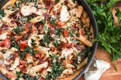 A perfect blend of bacon, spinach, chicken, and pasta in a savory garlic cream sauce.