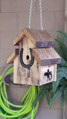 Reclaimed wood and horse related decorations. House Wren birdhouse.
