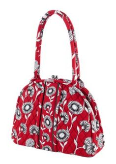 Eloise | Vera Bradley bags rock !  Washable, pretty, goes with everything.  Luggage to wristlets.