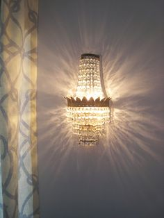 i love this sconce that throws such a beautiful pattern.