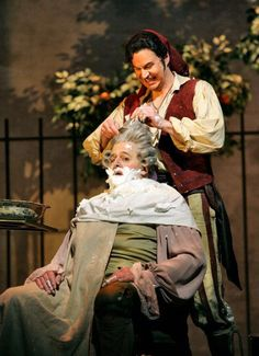 Peter Mattei (Figaro) and John Del Carlo (Dr Bartolo) in the Barber of Seville