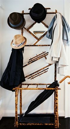 Ashley Putman - A bamboo coat rack covered with hats