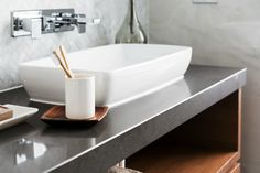 charcoal grey bathroom vanity top with white sink and stainless steel tap fixtures