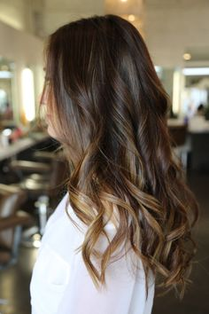 Dark brunette with carmel highlights.