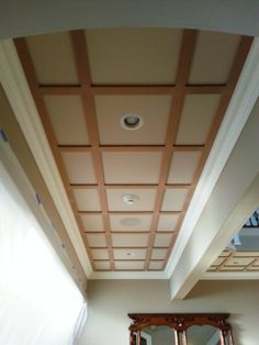 Start of a flat panel ceiling in a hallway.