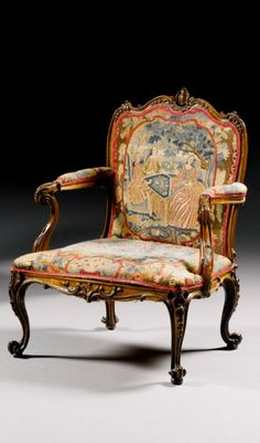 A Pair Of George III Carved Fruitwood Library Armchairs In The Manner Of  Thomas Chippendale,