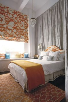 quick and easy way to change up the color in a room - curtains behind bed