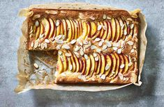 Try this summer twist on a classic Bakewell tart recipe, with juicy nectarines and melting marzipan, for a pretty dessert that is the perfect picnic idea. Find more Traybake recipes and Dessert recipes at Tesco Real Food. Tray Bake Recipes, Tart Recipes, Brownie Recipes, Baking Recipes, Baking Ideas, Oven Recipes, Drink Recipes, Bakewell Traybake, Bakewell Tart