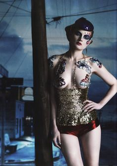 Guinevere Van Seenus by Paolo Roversi, Vogue UK. | fashion editorial | tattoo | sparkle | circus | vintage | pin up #pirate #fashion #editorial #tattoos #ink #gorgeous #corset #pinup
