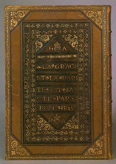 A copy of La Saincte Bible en Francoys, translated by Jacques Lefevre d'Etaples, vol.II. Book bound for Henry VIII and Anne Boleyn. This copy form Antwerp was made in 1534 and was specially bound for Henry VIII and Anne Boleyn. Crowned Tudor roses and 'HA' ciphers appear on the binding of both volumes together with evangelical texts in French.