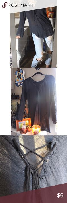 Dark Beachy/ Flowy/ Boho Top This shirt looks like something a goth hippie would wear lol! And that's not a diss, I love it! I just don't wear it much. Strings are made of what seems to be suede. Shirt is a little off centered but I think it was supposed to be made that way? I'm not sure but it's never bothered me much. Super cute for a night at the beach! Tops Blouses