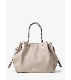 Dalia large leather tote by Michael Kors. Designed with python-embossed trim our Dalia tote is an exotic take on a timeless style. Its slou...