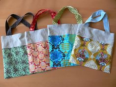 Roll up tote bags, cute, functional and kind enough to roll right up when you're not using them! Good tutorial....