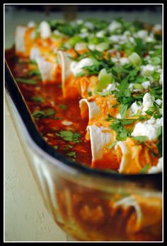 buffalo chicken enchiladas.  didn't have any gorgonzola on hand, so i just drizzled some blue cheese dressing over them after baking...yumm!