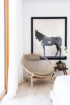 Equestrian print with vintage circle chair