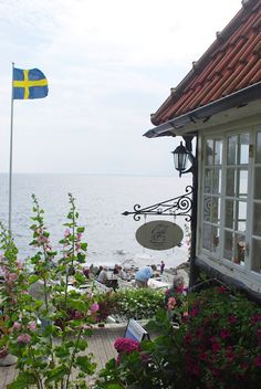 waterfront home in Sweden Swedish Girls, Swedish Style, Swedish Flag, Swedish Cottage, Swedish House, Scandinavian Countries, Scandinavian Home, Sweden Travel, Waterfront Homes