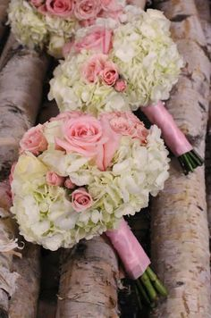 Vintage bridal bouquet with white hydrangea, pink roses and pink spray roses. Designed by Eastern floral for a wedding at The Goei Center.