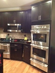 Remodel kitchen on pinterest espresso cabinets dark for Chocolate kitchen cabinets with stainless steel appliances