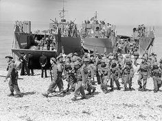 Canadian troops disembarking from a landing craft during a… | Flickr