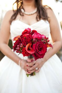 Monochromatic red bouquet with roses, callas, garden roses, hypericum, ranunculus and spray roses. Photo by Stef Atkinson. Flowers by Brocade Designs