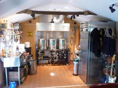 This is one awesome home-brewery set up. Someday....