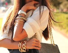 Sheer blouse + chunky gold jewelry = always an A+ move.