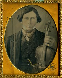 Long Haired Concert Violinist, Extreme Close-Up, Ninth Plate Daguerreotype. He Holds His Violin & Bow in the Air. His Pinky Ring, Tie Clip, and Chain Are Tinted Gold. Antique Photos, Vintage Photographs, Old Photos, Old Images, Vintage Images, Vintage Men, Old Country Music, Violin Bow, Tintype Photos