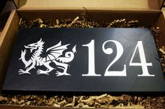 It can be hard to find a house sign that is exactly how you want it.  Our Welsh slate house signs are handmade to order, and can be designed in store with our Swansea team or online!
