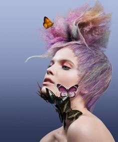 The pastel hair colours in this avant garde hair style are beautiful