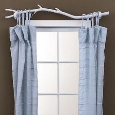 Our bedroom is somewhat rustic chic. I would love to use a branch for our curtain rod.