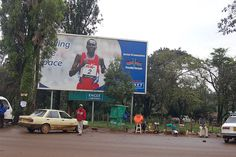 Billboard of a runner in Eldoret, Kenya where most of Kenya's world famous runners come from by vreefick, via Flickr