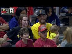 Dad makes awesome one-handed home run catch while holding his baby | fox8.com