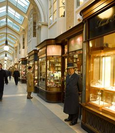 Burlington Arcade.Burlington Arcade runs from behind Bond Street to Piccadilly. The arcade is a traditionally upmarket shopping venue, known for its jewelry, expensive fashions, antiques and other luxury goods. www.burlington-arcade.co.uk