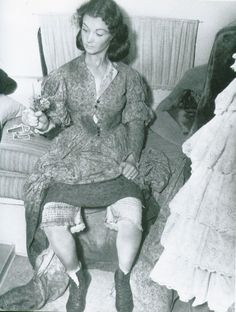 """4:00AM.Photograph featuring an exhausted, tired, and muddy Vivien Leigh holding a small bouquet of flowers that had just been given to her by Arthur Arling, the Camera Operator for Gone With The Wind. During the production Miss Leigh and Arling became close friends and she would often confide/complain to him regarding daily script changes, Gable's bad breath, and the never ending retakes. Arlings advice to her was; """" Don't worry, when you get the Academy Award for this, it will all be worth…"""