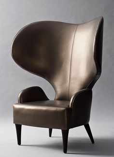 Hathi Side Chair 1,080mm (W) X 1,330mm (H) X 745mm (D) Leather upholstered chair with black lacquered…