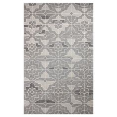 Anchor your living room seating group or define space in the den with this artfully hand-hooked wool rug, showcasing a geometric tile motif for eye-catching ...