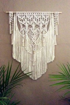 Large Macrame wall Hanging Tapestry This is a fabulous layered Bohemian Large Macrame Wall Hanging with brass tubes and beading. Everyone will be astonished by what beauty is on your walls. This is modern macrame at its best. This would look beautiful over your bed, gracing your living room, hallway or anywhere else you want the ordinary transformed into stunning.  Original design and crafted by Lucy Lanuza    Made of: Soft cotton rope Soft cotton twine Brass tubes and beads   Si...
