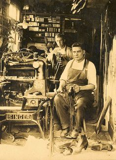 Charles L. Rossing with his son, Bill, in his shoe repair shop | Unionville, Connecticut, early 1900's | photo from trecrowns