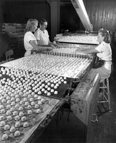 1952 photo of the Brock Candy Company in Chattanooga. Here chocolate covered cherries, a Valentine's Day favorite, receive the bottom coat of chocolate.