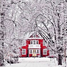 Red barn style home in the snow