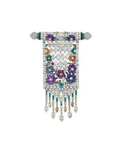 AN ART DECO DIAMOND, COLORED DIAMOND AND MULTI-GEM BROOCH Designed as a pierced curved bar with diamond palmette terminals suspending an articulated plaque of marquise-cut diamonds and carved ruby, emerald, sapphire, amethyst or citrine flowerheads with diamond-set borders to the emerald, diamond and yellow diamond tassels, circa 1930.